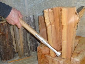 Pry apart the wood with your K-Axe kindling axe